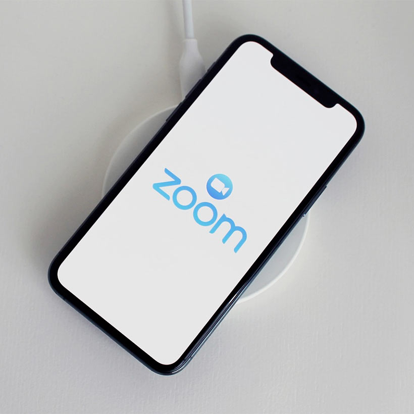 A phone displaying the Zoom video conferencing logo
